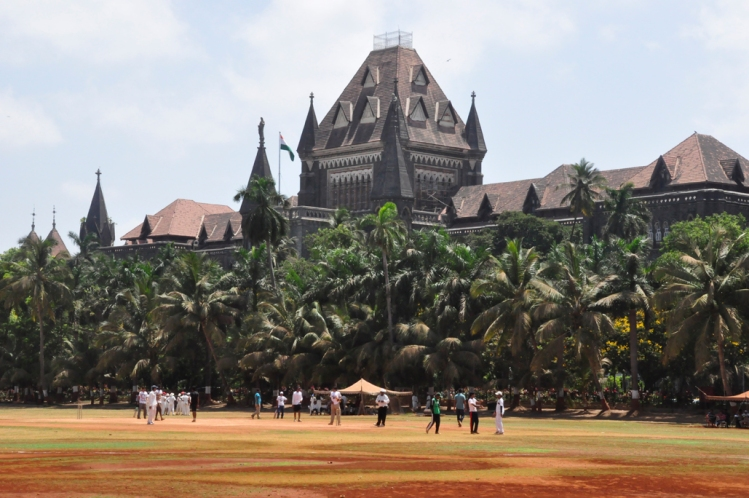 cricket being played @ Oval Maidan in front of the Bombay High Court