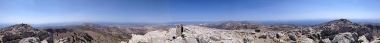On the summit of Mount Zeus on Naxos. The islands of Paros, Little Cyclades, and Mykonos in the distance.