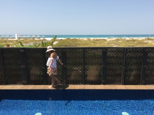 Playing at the edge of the villa's private pool